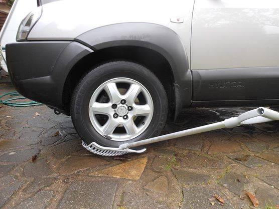 rake under car